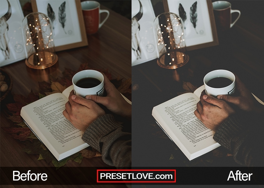 A person wrapping his hands around a coffee mug over an open book